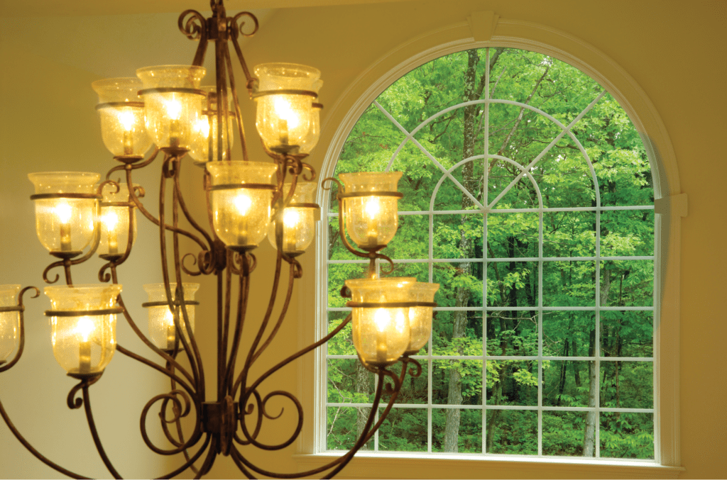 This arched window mimics the curves of the chandelier for a design that works throughout the entire home