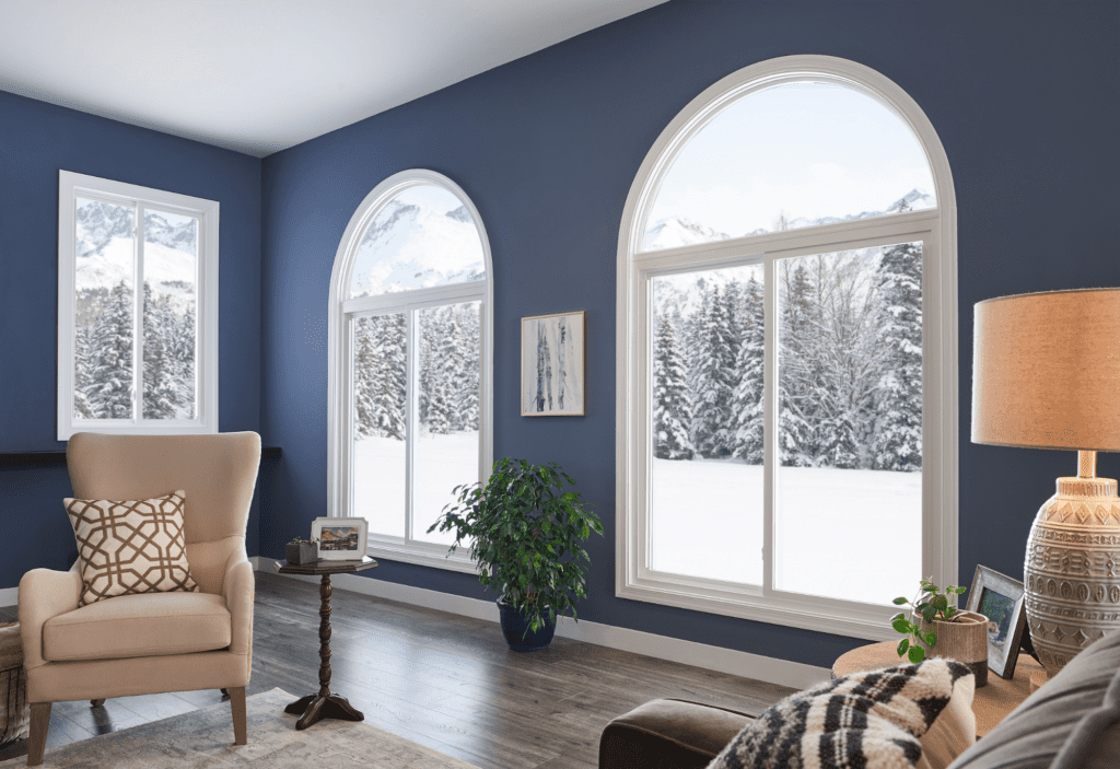 Two large sliding windows overlooking a snow-covered lawn.